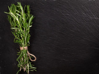 Rosemary herb bunch over stone