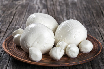 mozzarella balls on a clay dish, close-up