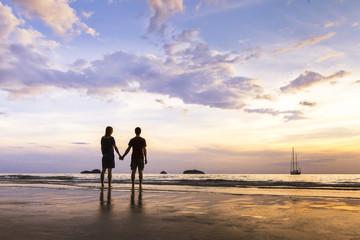 Happy couple having a romantic walk near the sea