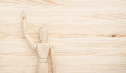 Greeting figure on wooden background