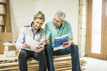 Senior couple reading manual