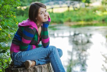Girl sits on stub