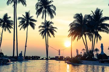 Beautiful sunset on a tropical sea coast with palm trees.