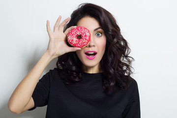 Portrait of beautiful young woman with donut
