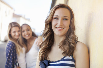 Teenage girl, friends in background
