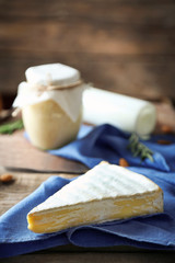 Set of dairy products on wooden table closeup