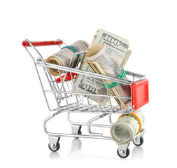 Small shopping trolley with dollars banknotes isolated on white