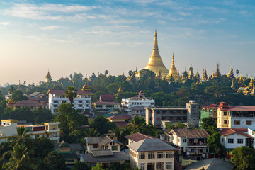 Shwedagon pagoda with Yangong cityscape foreground in shiny day Myanmar.