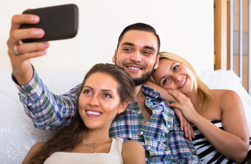 Friends making selfie at home.