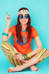 Beautiful hippy girl portrait sitting and smoking weed