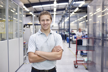 Portrait of worker with arms folded in engineering factory