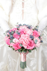 Pink bridal bouquet of roses and carnations