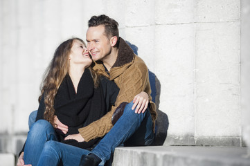 Romantic couple sitting on steps