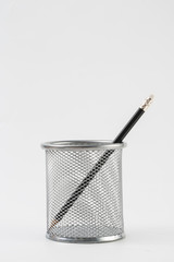 pencils in metal pot on a white background