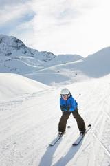 Boy skiing downhill, Les Arcs, Haute-Savoie, France