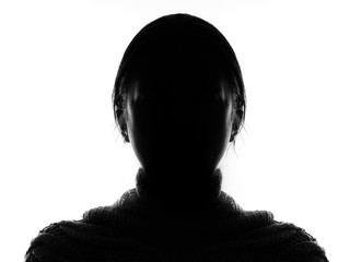 Hidden face in the shadow.Female silhouette.