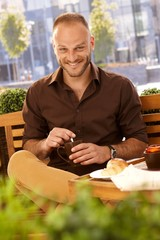 Outdoor photo of happy man with coffee