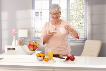 Happy old woman eating healthy