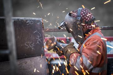 Metal grinding in repair works in surface coal mine