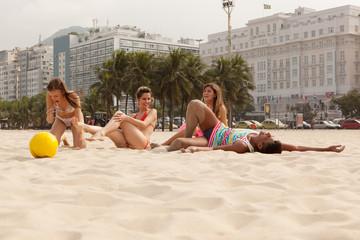 Young people relaxing on Copacabana Beach, Rio De Janeiro, Brazil