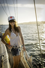 Portrait of young woman standing on boat