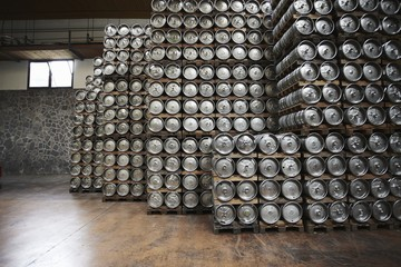 Casks of beer stacked in a brewery