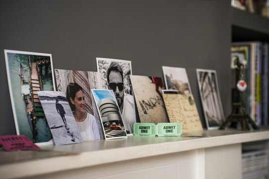 Living room mantelpiece with travel souvenirs and photographs
