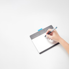 graphic designer or retoucher hands writing on digital tablet with copy space for graphic design or website