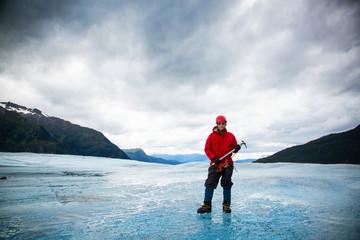 Man with ice pick on Mendenhall Glacier, Alaska, USA