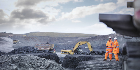 Miners in discussion in surface coal mine