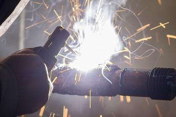 welding (worker welds)