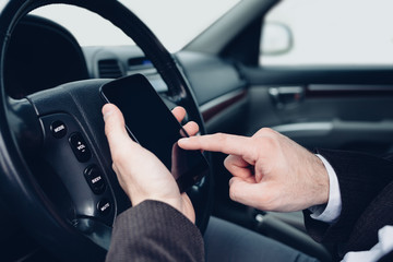 Man using mobile phone in the car