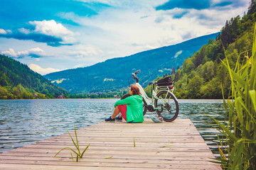 woman with e-bike resting beside a beautiful lake-e-power 20