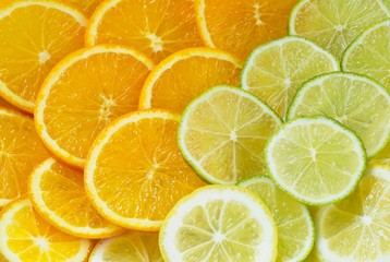 Healthy background with colourful slices of oranges, lime and lemon