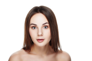 Beauty portrait of pretty SURPRISED girl with natural makeup. Beautiful spa woman touching her face. Perfect fresh skin. Pure beauty model girl. Youth and skin care concept