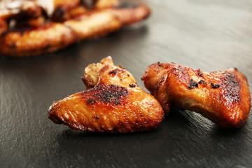 Baked chicken wings on slate plate