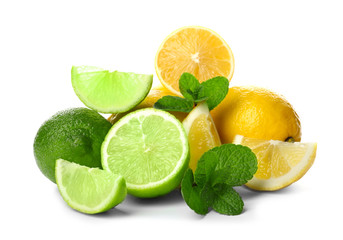 Ripe lime and lemon with slices and green leaves isolated on white