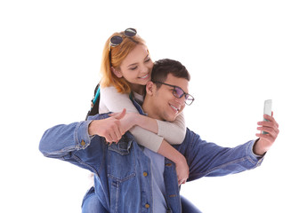 Young couple taking selfie with mobile phone isolated on white