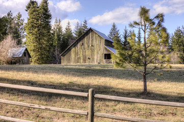 Rustic old barn on clear day.
