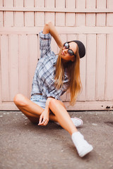 Sensual lady lay on the wooden floor and make some pictures,outside,heels,denim outfit,adventure trip,camera shooting,selfie woman