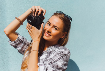Close up lifestyle details,young hike hipster woman holding retro sunglasses,golden jewelry,warm colors.holding vintage retro camera on her hands,stylish classic accessorizes