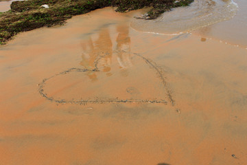 Love:Heart on Sand Beach, Tropical Ocean. suitable background for a variety of traveling and holiday/love designs.