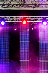 outdoor stage with spotlight and screens