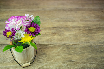 A bouquet of flowers on a wooden floor blank.