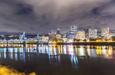 water with reflection and cityscape and skyline of portland at n