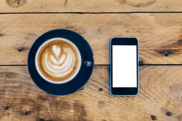 Mobile Phone with a White Screen with a Cappuccino on the Wooden