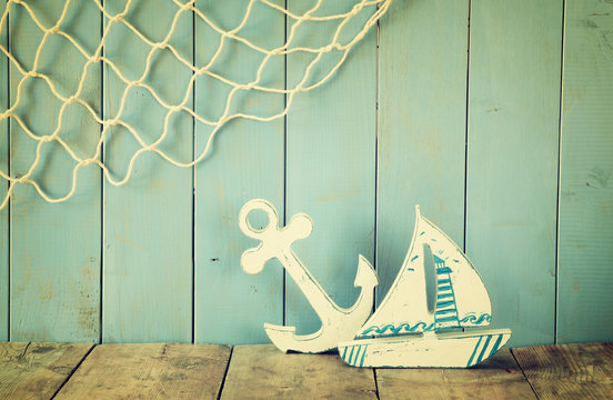 nautical life style objects on wooden table. vintage filtered