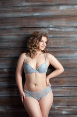 curve plus size female in gray lingerie