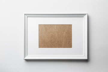 White plain empty  wood picture frame with white mat passe-partout on white bricks background