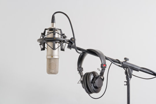 Professional  microphone with headphones on a stand.